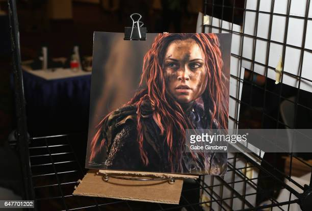 A digital artwork of the character Wanheda from The 100 television series by illustrator Samantha Dodge is displayed the ClexaCon 2017 convention at...