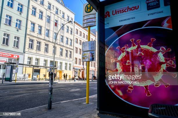 A digital billboard at a tram stop shows a microscopic rendering of the SarsCoV2 virus in Berlin on March 22 amid a new coronavirus COVID19 pandemic
