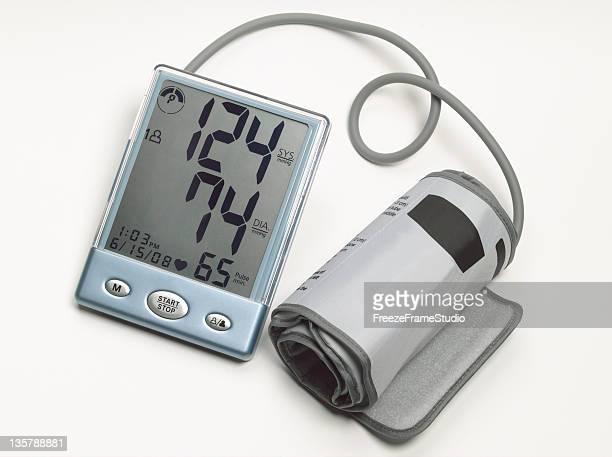 Digital blood pressure monitor & cuff on white