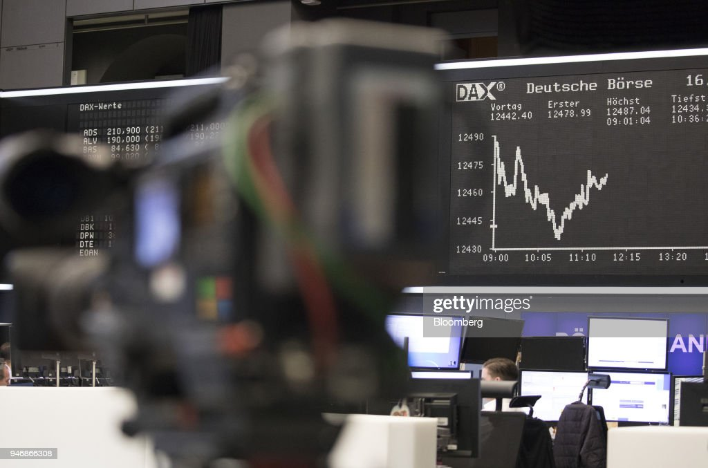 A digital board shows the DAX Index curve as traders work at the Frankfurt Stock Exchange, operated by Deutsche Boerse AG, in Frankfurt, Germany, on Monday, April 16, 2018. Bonds declined, stocks were steady and oil fell on anticipation that the fallout from missile strikes in Syria will be limited. Photographer: Alex Kraus/Bloomberg via Getty Images
