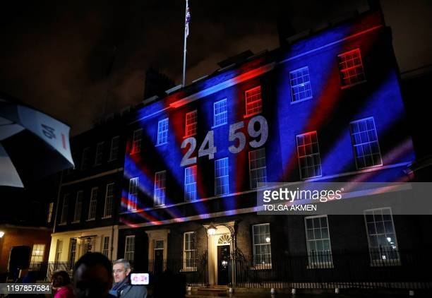 A digital Brexit countdown clock is projected onto the front of 10 Downing Street the official residence of Britain's Prime Minister in central...