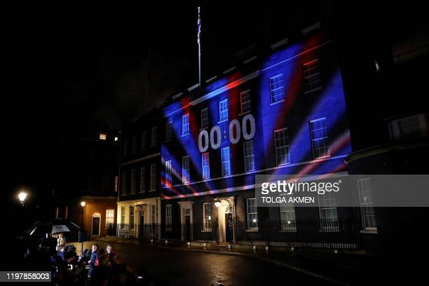 A digital Brexit countdown clock shows 0000 as the time reaches 11 o'clock as it is projected onto the front of 10 Downing Street the official...