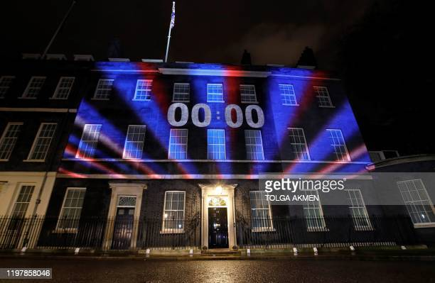 TOPSHOT A digital Brexit countdown clock shows 0000 as the time reaches 11 o'clock as it is projected onto the front of 10 Downing Street the...