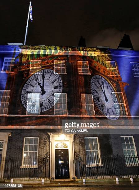A digital Brexit countdown clock shows the clock face of the Elizabeth Tower commonly known as Big Ben as it strikes 11 o'clock as it is projected...