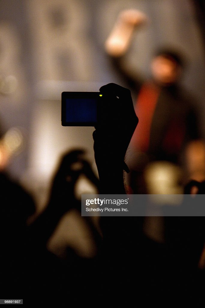 Digital camera capturing out of focus rock concert : Stock Photo