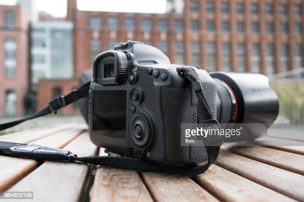 digital camera, lying on a table - digital camera stock pictures, royalty-free photos & images