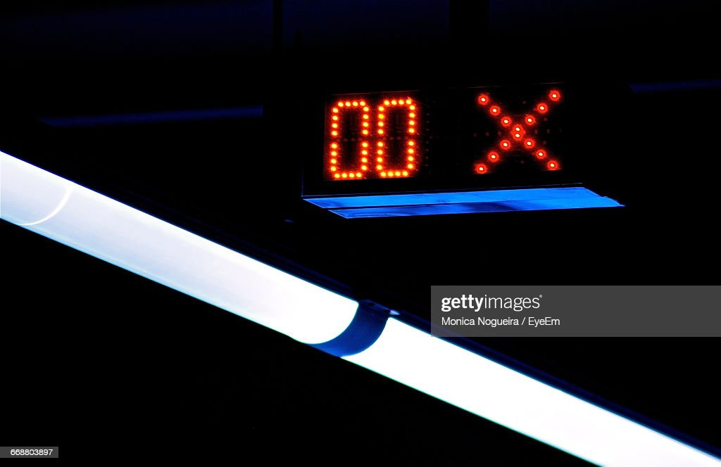 Digital Clock And Fluorescent Light Stock Photo - Getty Images