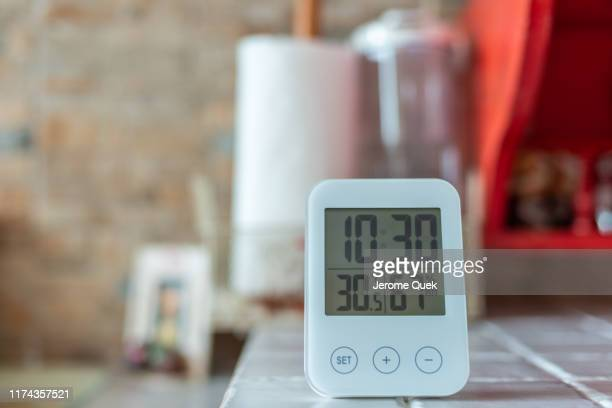 digital clock with temperature & humidity sensor - digital thermometer ストックフォトと画像