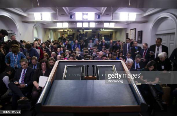 Digital clocks sit on a podium while members of the media wait for a White House briefing in Washington DC US on Tuesday Nov 27 2018 President Donald...