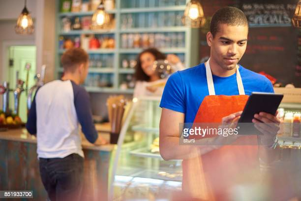 digital coffee shop - accounting stock photos and pictures
