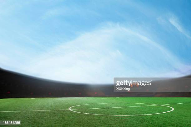digital composit of soccer field and blue sky - soccer scoreboard stock photos and pictures