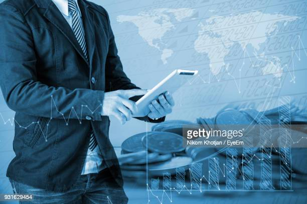 Digital Composite Image Man Using Digital Tablet By Graph And Coins
