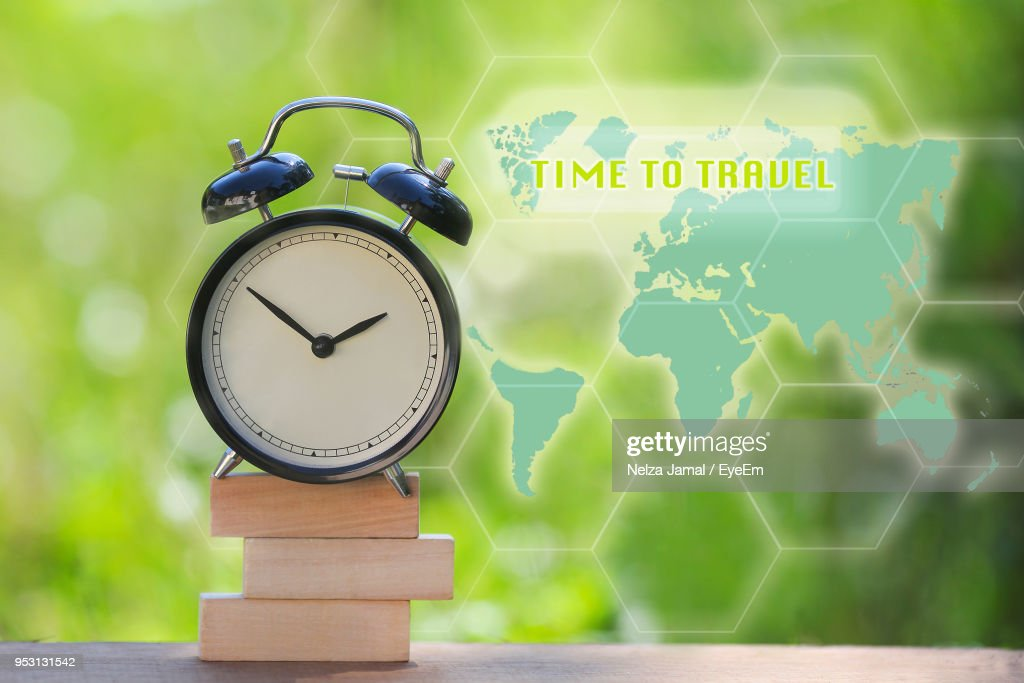 Digital composite image of alarm clock on books by world map stock digital composite image of alarm clock on books by world map gumiabroncs Image collections