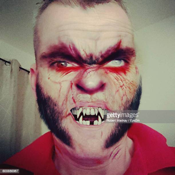 digital composite image of angry man at home - ugly people stock-fotos und bilder