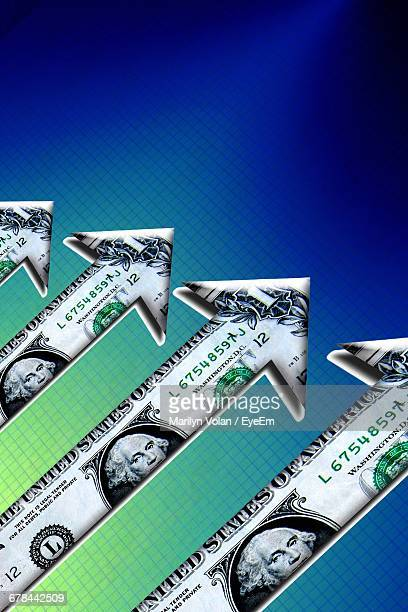 Digital Composite Image Of Arrow Made Of Dollar Against Blue Background