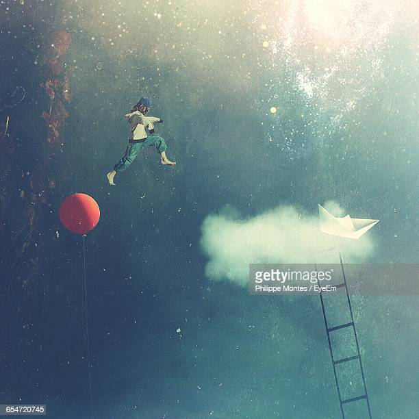 Digital Composite Image Of Boy Jumping In Sky