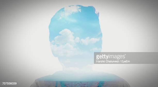 Digital Composite Image Of Boy On Sky