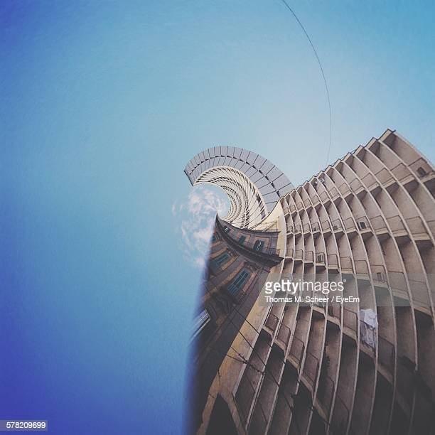 digital composite image of building against clear blue sky - digital distortion stock photos and pictures