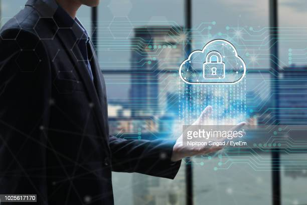 digital composite image of business man with cloud computing icon - security system stock pictures, royalty-free photos & images