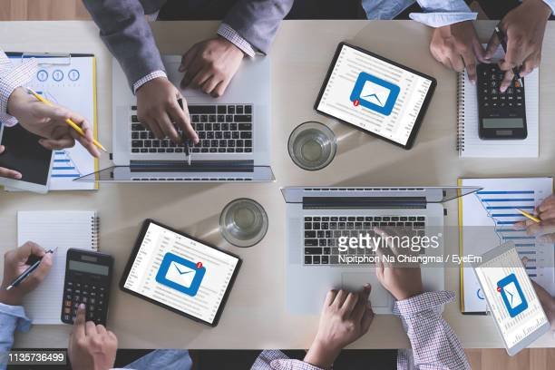 digital composite image of business people working on desk with mail notifications - correspondence stock pictures, royalty-free photos & images