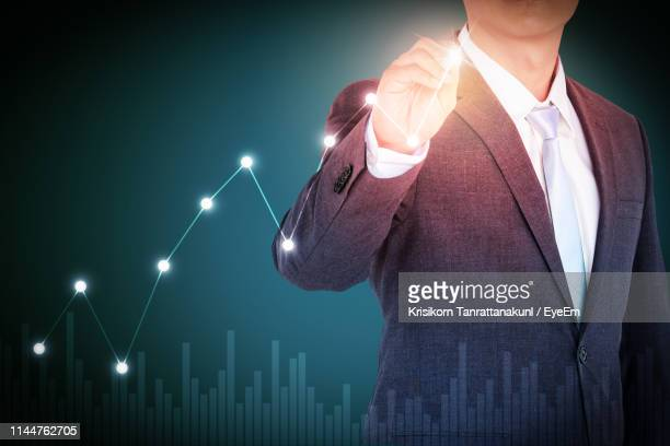digital composite image of businessman connecting dots against colored background - connect the dots stock pictures, royalty-free photos & images