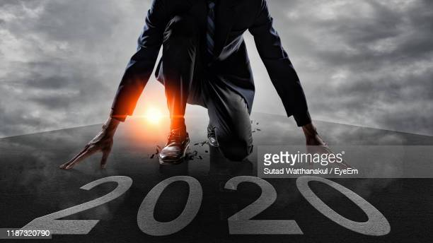 digital composite image of businessman kneeling by number 2020 - 2020年 ストックフォトと画像