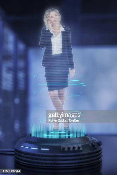 digital composite image of businessman over projection equipment on table - hologram stock pictures, royalty-free photos & images