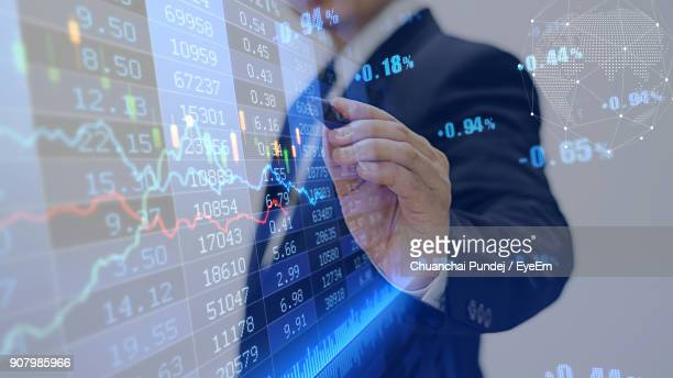 Digital Composite Image Of Businessman Touching Data With Pen