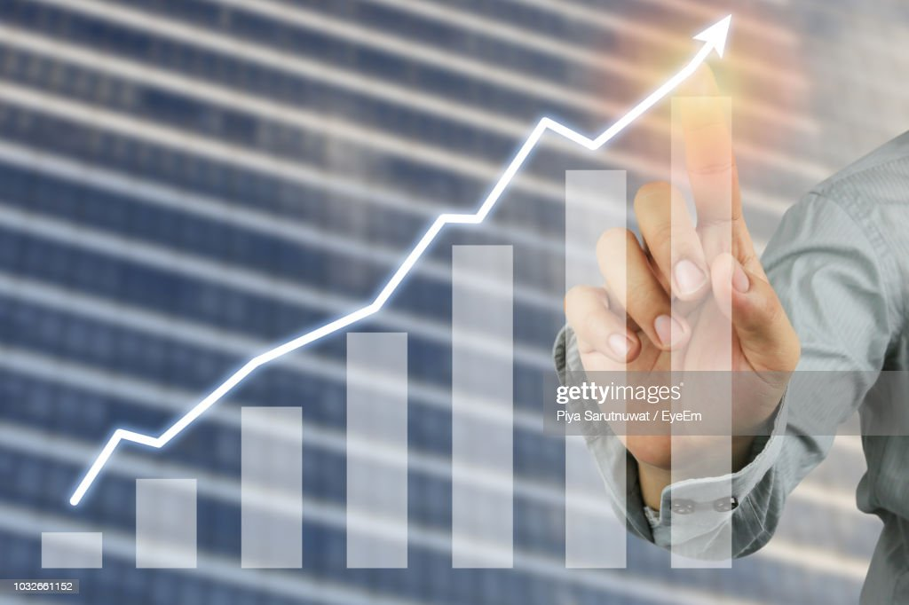 Digital Composite Image Of Businessman Touching Graph On