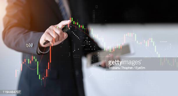 digital composite image of businessman touching screen - mid adult stock pictures, royalty-free photos & images