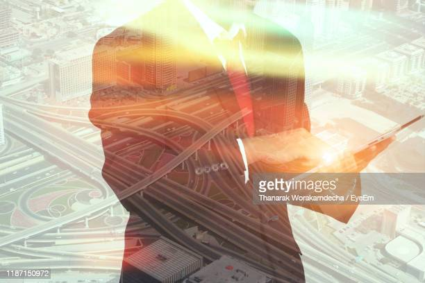 digital composite image of businessman with cityscape - digital composite stock pictures, royalty-free photos & images