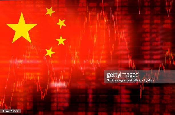 digital composite image of chinese flag against chart - chinese flag stock pictures, royalty-free photos & images