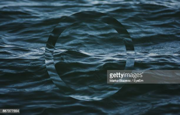 digital composite image of circle in sea - digital composite stock pictures, royalty-free photos & images