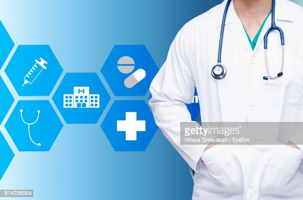 Digital Composite Image Of Doctor Standing Against Blue Background With Various Icons