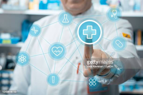 digital composite image of doctor touching icons - medical icons stock pictures, royalty-free photos & images