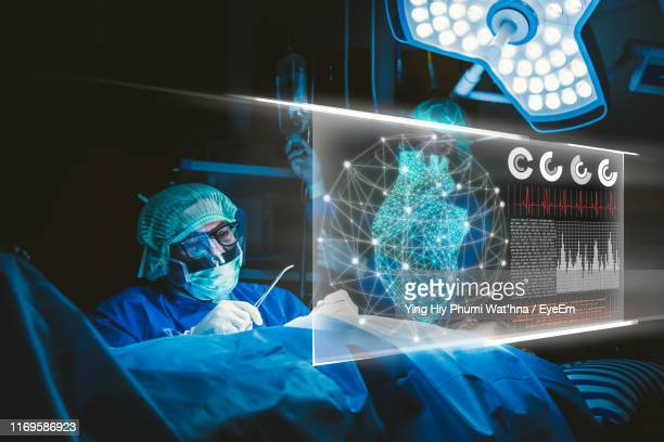 digital composite image of doctor working in hospital - digital health stock pictures, royalty-free photos & images
