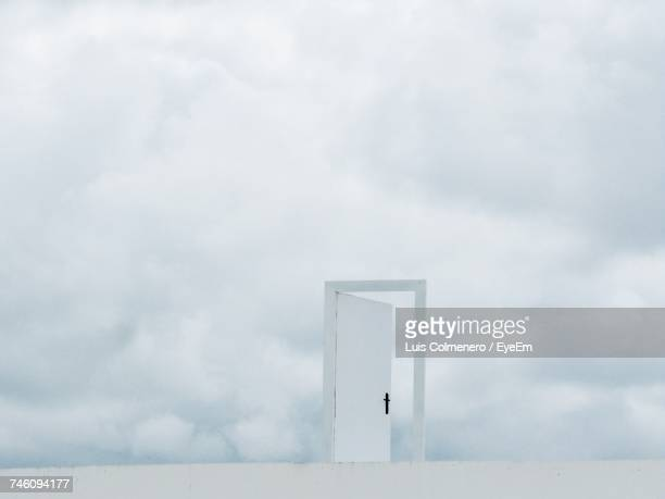 Digital Composite Image Of Door Frame Against Cloudy Sky