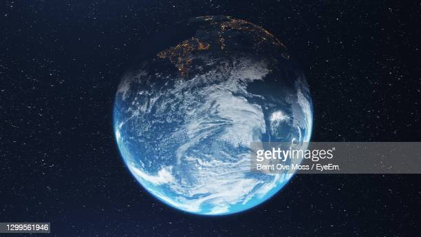 digital composite image of earth amidst star field at night - global stock pictures, royalty-free photos & images
