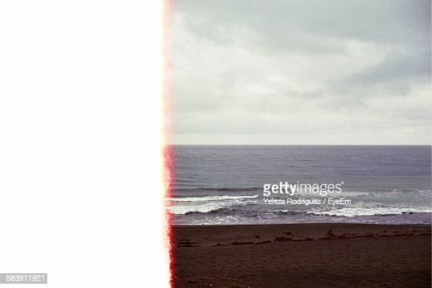 Digital Composite Image Of Fire And Beach