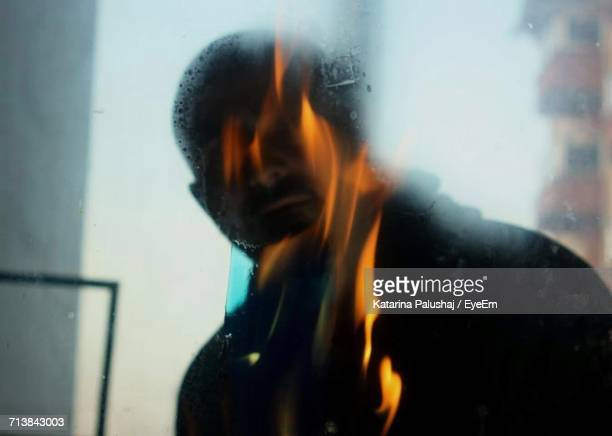 Digital Composite Image Of Fire And Man