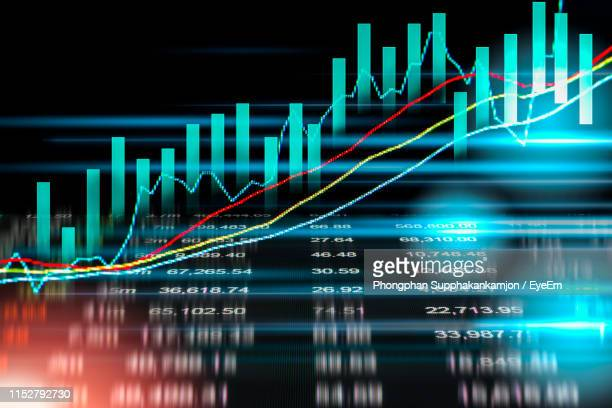 digital composite image of graph and financial figures - financial figures stock pictures, royalty-free photos & images