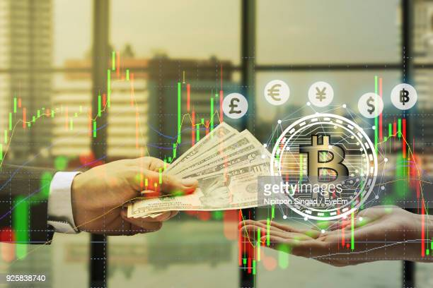 digital composite image of hand giving us dollars and bitcoin - bitcoin stock pictures, royalty-free photos & images