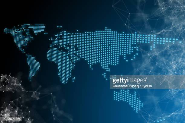 digital composite image of icons against blue background - world map stock photos and pictures