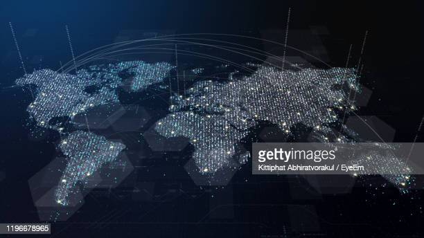 digital composite image of illuminated map - global communications stock pictures, royalty-free photos & images