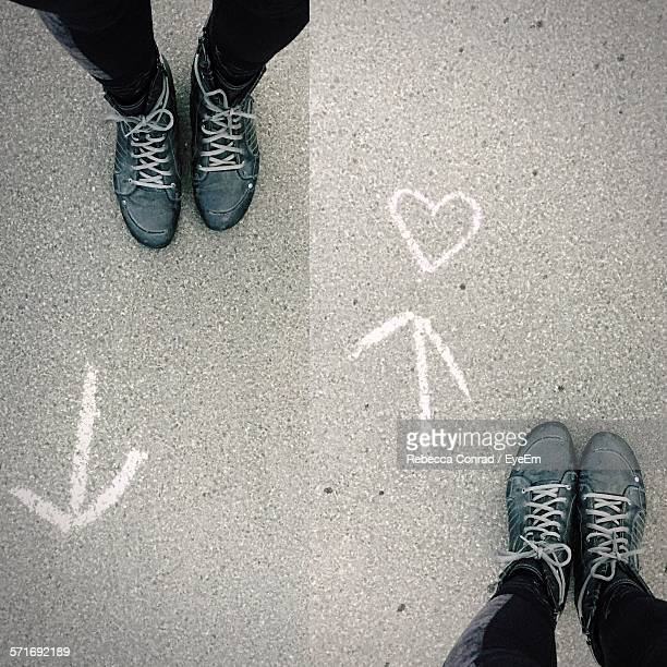 Digital Composite Image Of Legs With Arrow Symbol And Heart Shape On Street