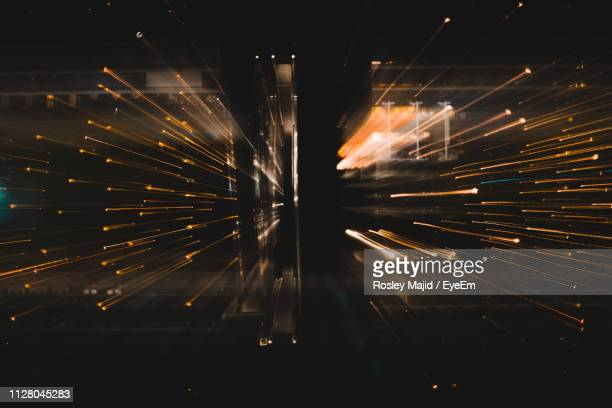 digital composite image of light trails in room - digital composite stock-fotos und bilder