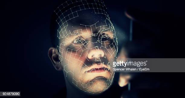 Digital Composite Image Of Man Against Black Background