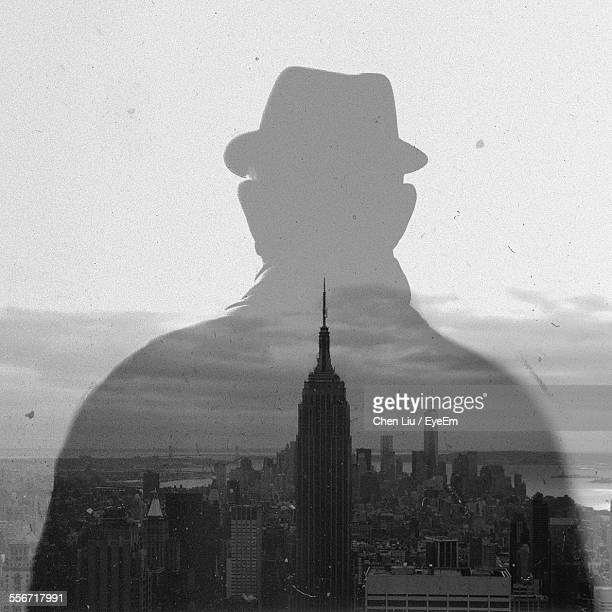 Digital Composite Image Of Man And Empire State Building Against Sky