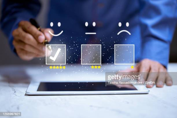 digital composite image of man using smart phone - customer engagement stock pictures, royalty-free photos & images