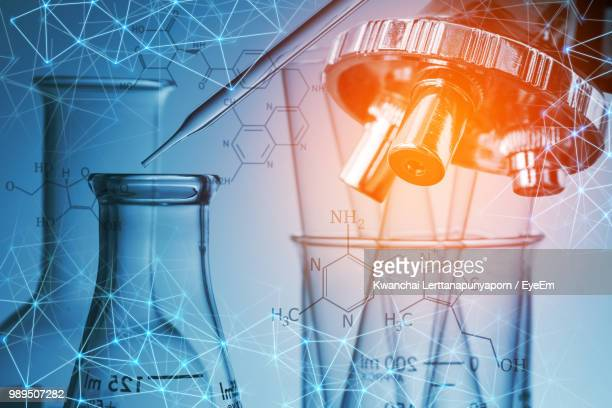 digital composite image of molecular structure with test tubes and equipment - science and technology stock pictures, royalty-free photos & images